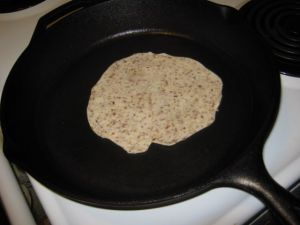 Cooking the first side of the Chapati.