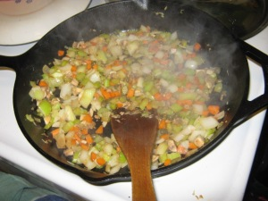 Vegetables browning in oil and anchovy paste.